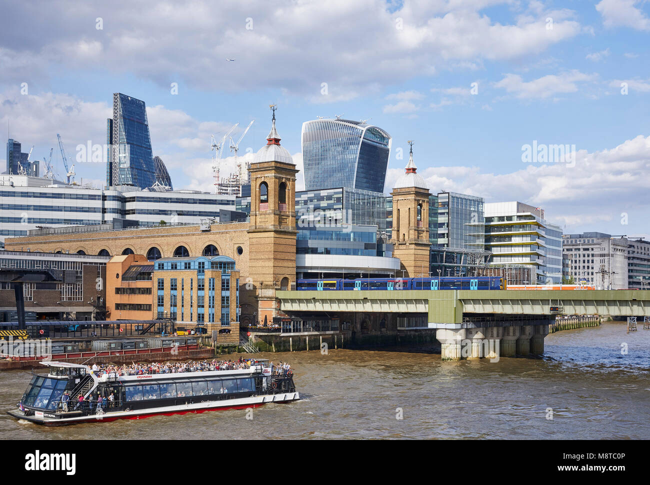 View of the River Thames with 20 Fenchurch Street and Cannon Street Railway Bridge. The River Building, London, - Stock Image