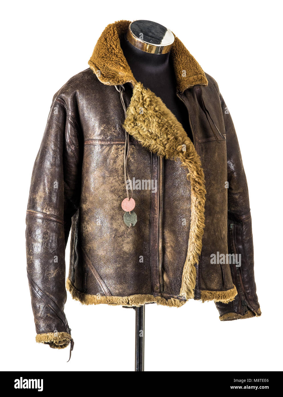 WW2 Irvin pattern brown leather flying jacket with sheepskin fleece lining and identity tags belonging to Air Gunner - Stock Image