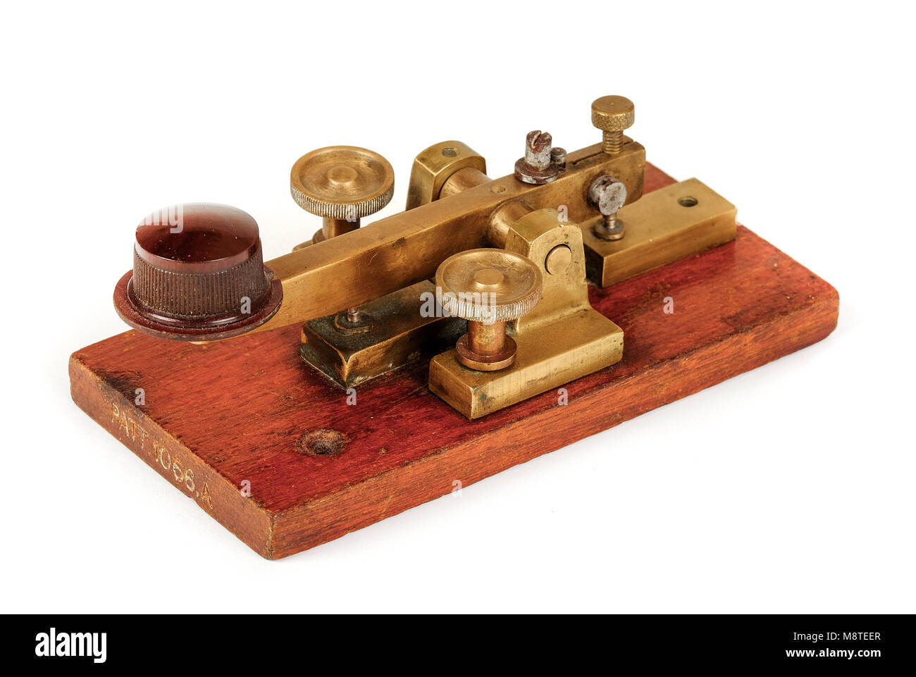 Early antique GPO (British Post Office) telegraph key for sending telegram messages using Morse Code, Patent No - Stock Image