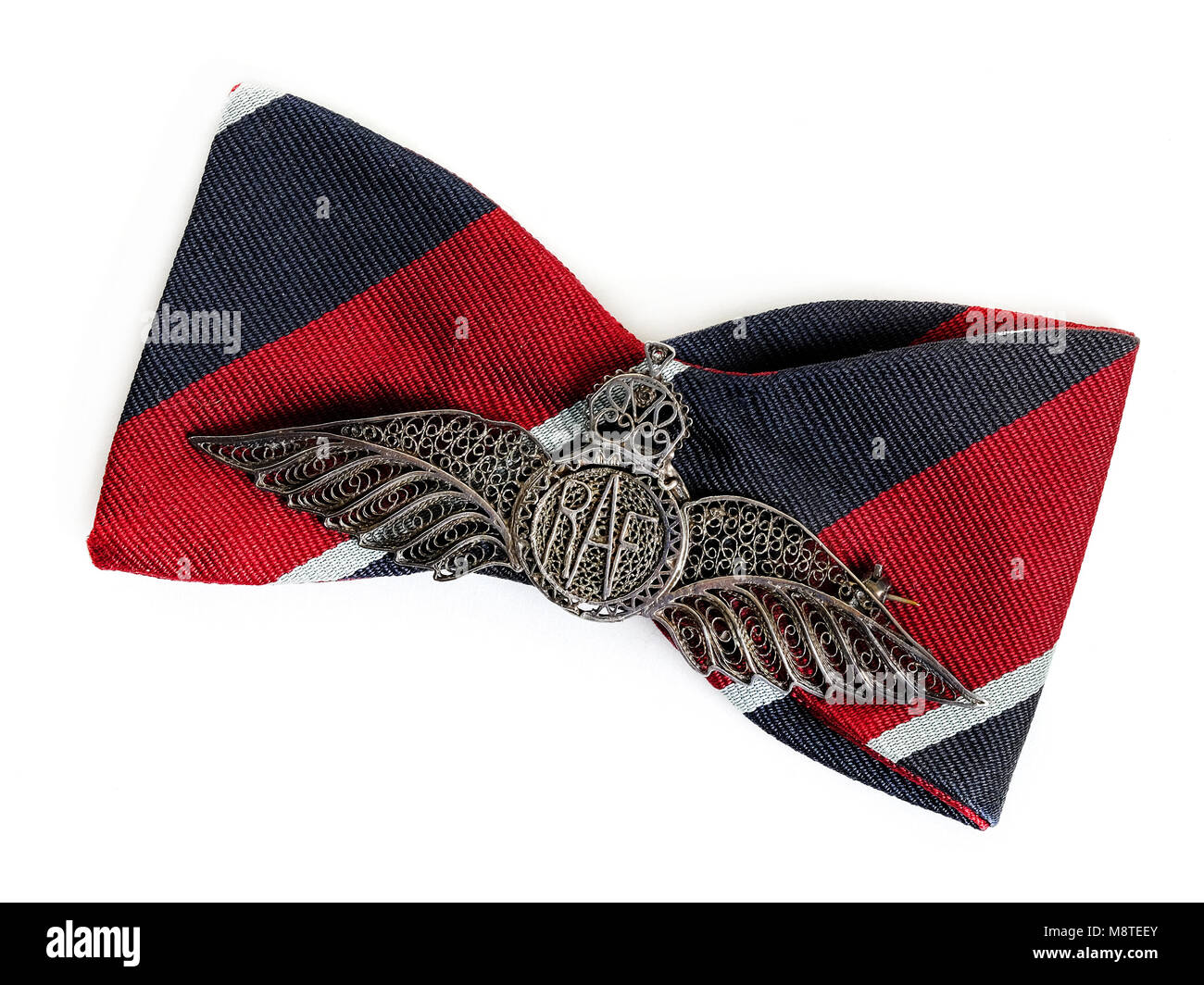 WW2 British RAF wings badge of silver filigree construction, probably made in India, mounted on a bow tie - Stock Image