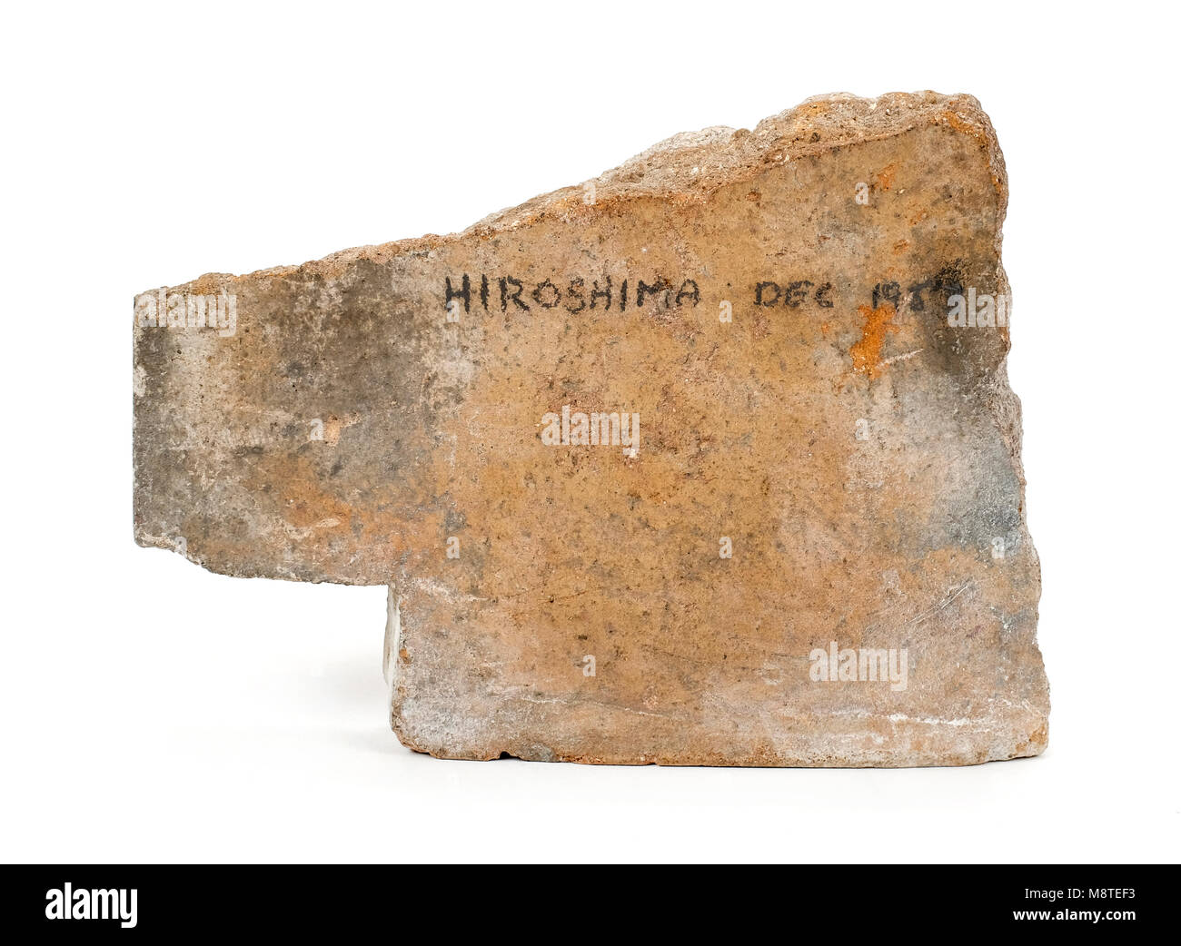 Roof tile from a building in Hiroshima, Japan, brought back in 1953, and showing a heat mark caused by the intense - Stock Image