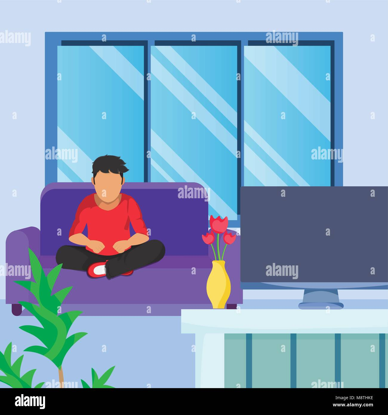 Young Man Seated On Armchair Seeing Tv   Stock Image