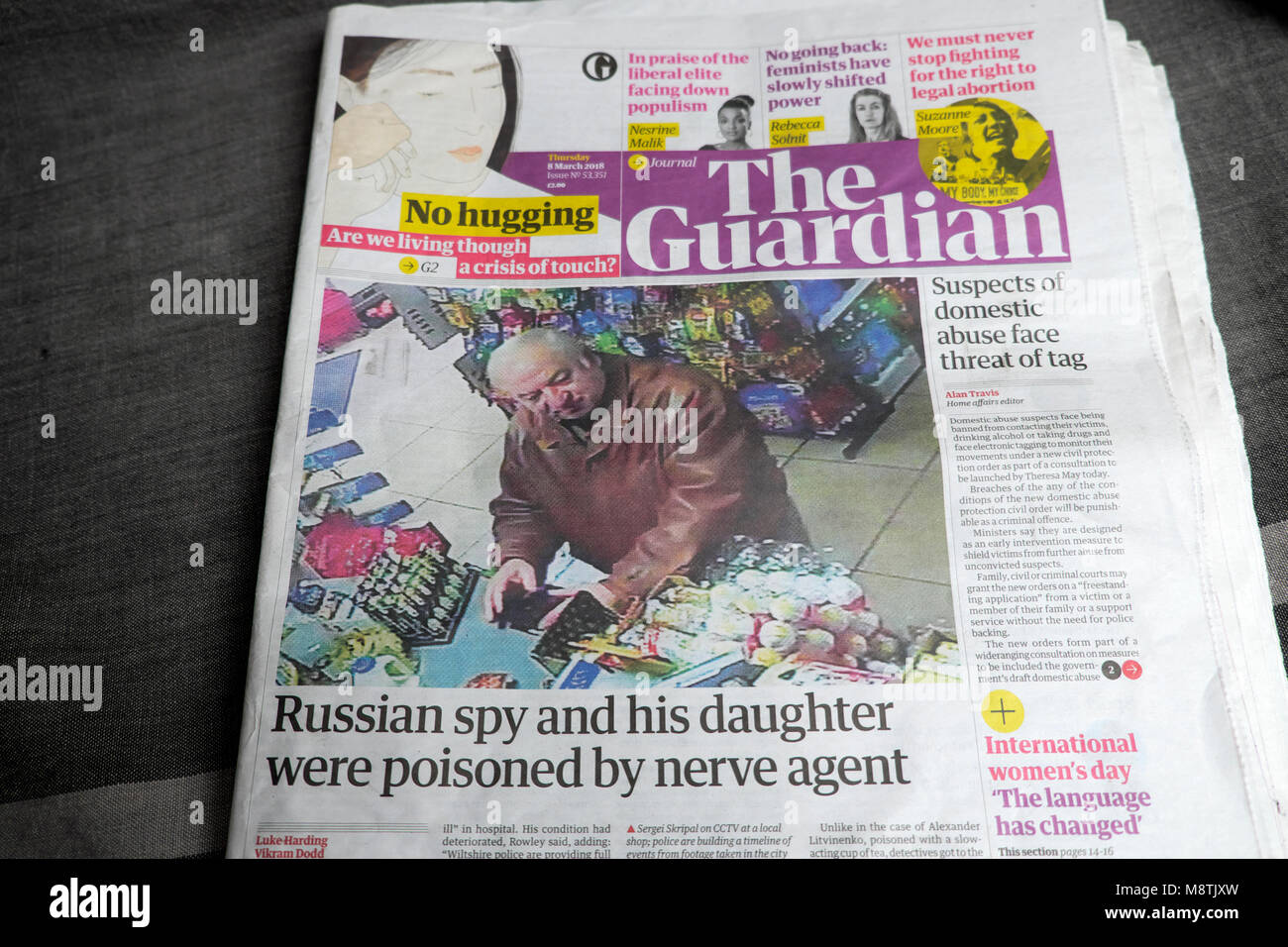 'Russian spy and his daughter were poisoned by nerve agent' front page headline in Guardian newspaper UK - Stock Image