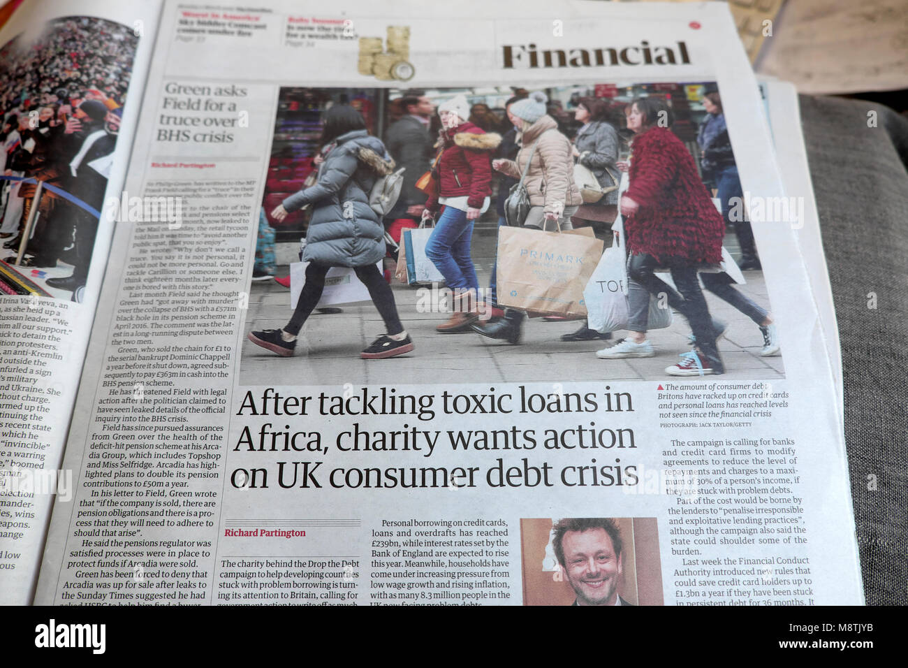 'After tackling toxics loans in Africa, charity wants action on UK consumer debt crisis' Guardian newspaper - Stock Image