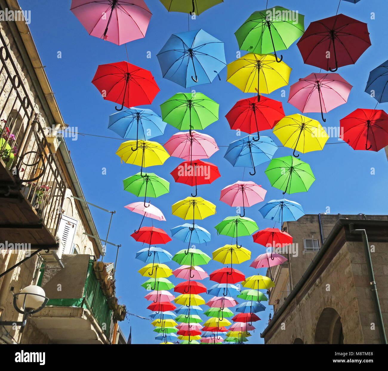 Summer street festival with flying umbrellas in Jerusalem - Stock Image