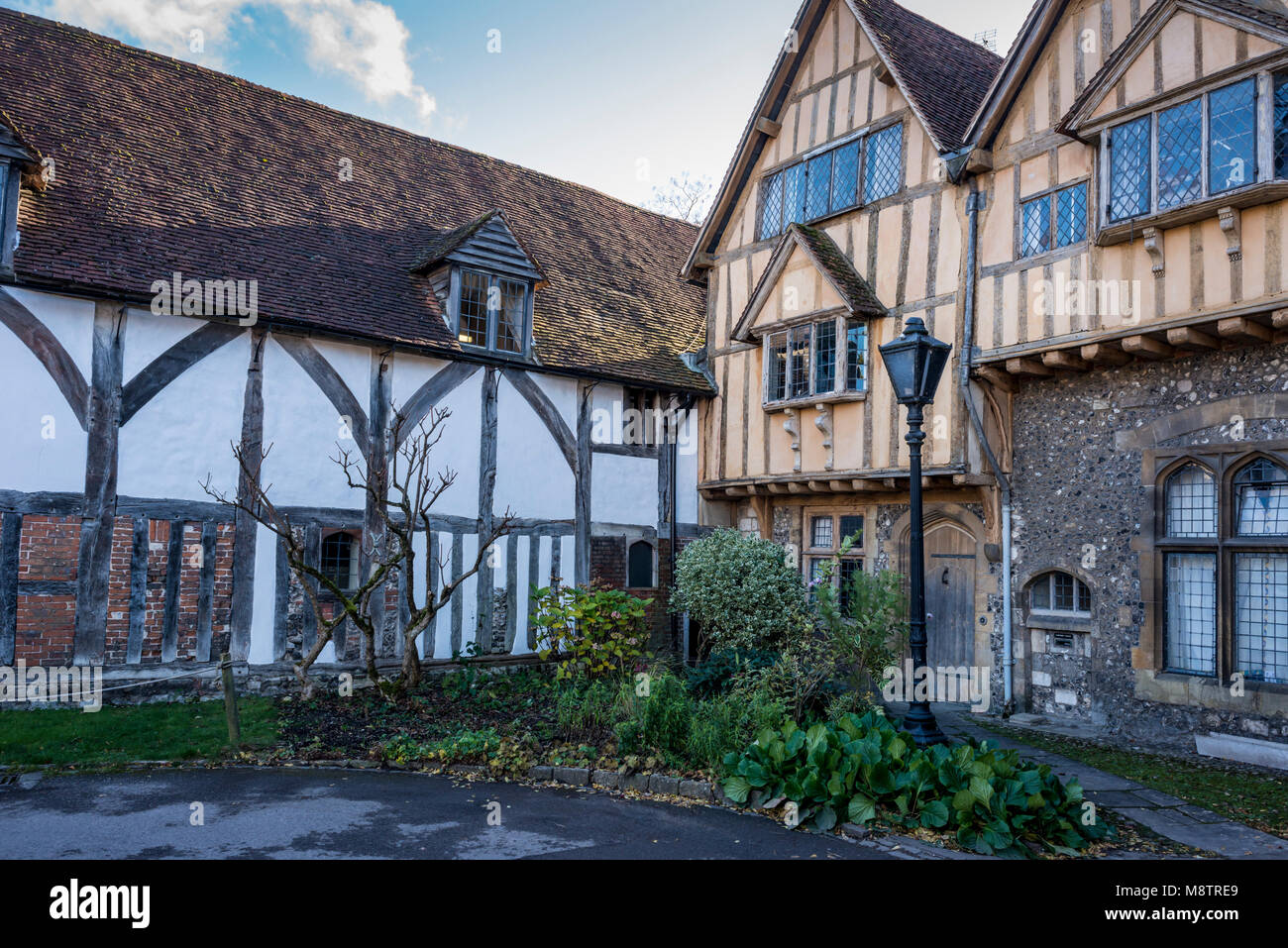 Cheyney Court, Elizabethan timber-framed building, Winchester Cathedral Grounds, Hampshire, UK - Stock Image