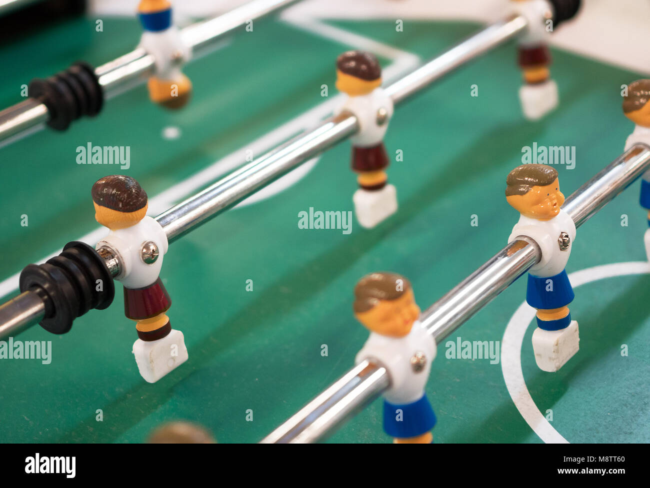 Table football game in kids playroom. - Stock Image