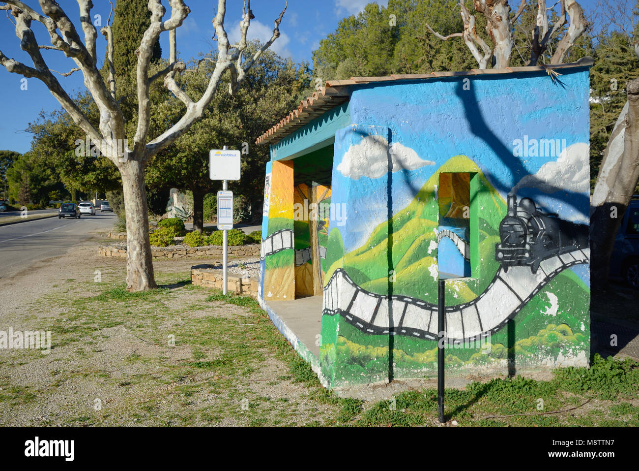 Bus Stop Painted with Image of Early Movie 'Arrival of a train at La Ciotat' filmed by the Lumière - Stock Image