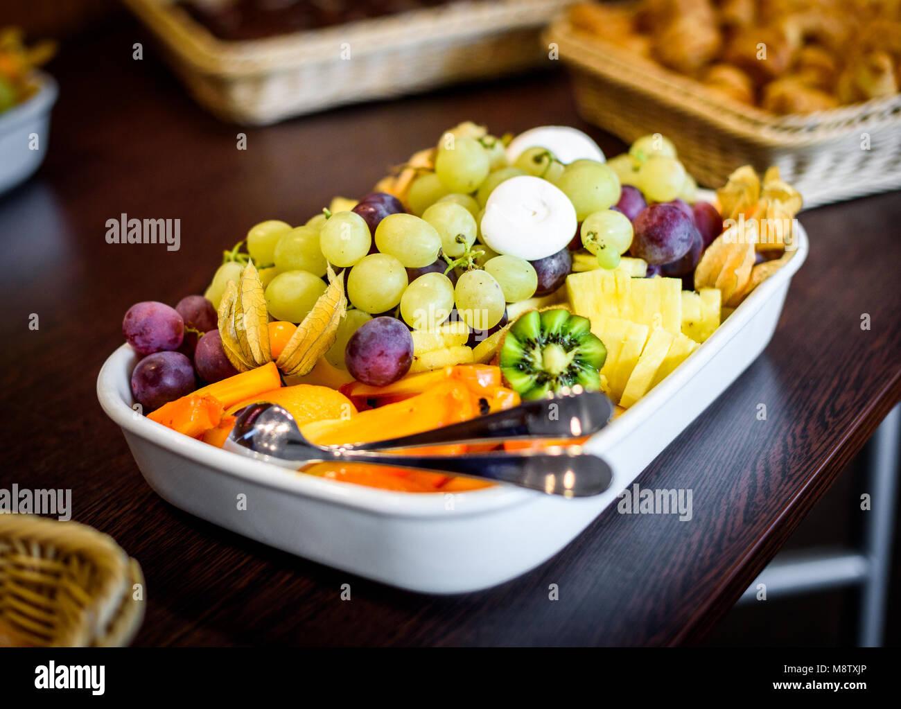 Fruit platter bowl buffet at business or wedding event venue. Self ...
