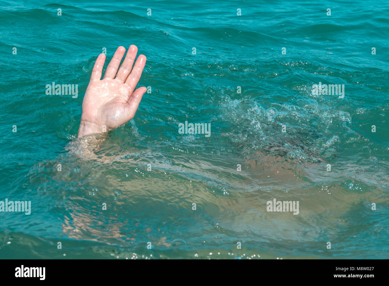 A sinking person the salvation of a drowning man stock image