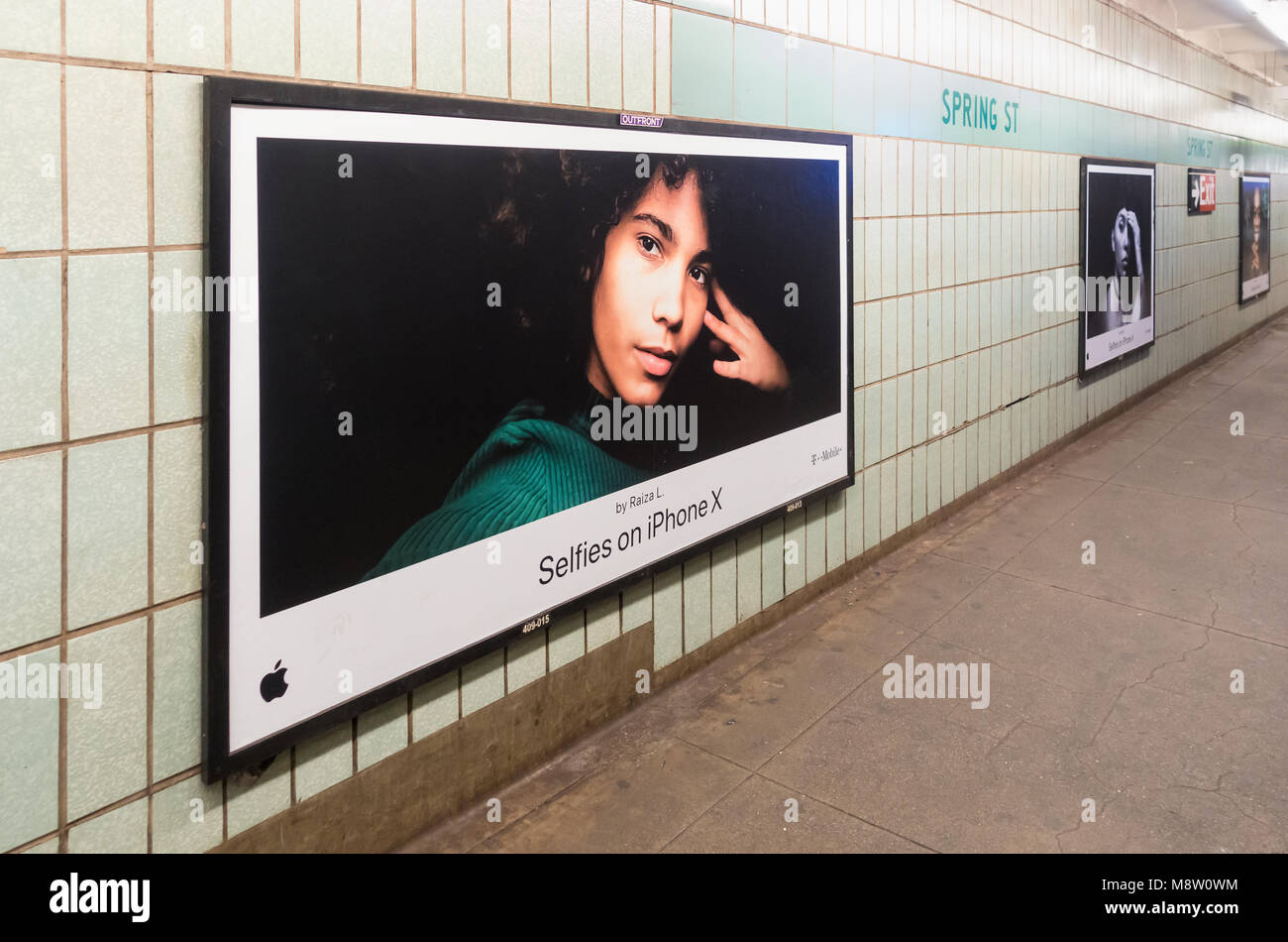 iPhone ads in the Spring Street Subway station promoting selfies made with the iPhone X (10) - Stock Image