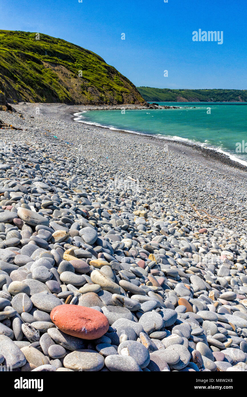 Greencliff Beach - Pebble View at Mid Tide, Looking South West towards Bucks Mills: Greencliff Beach, Near Bideford, - Stock Image