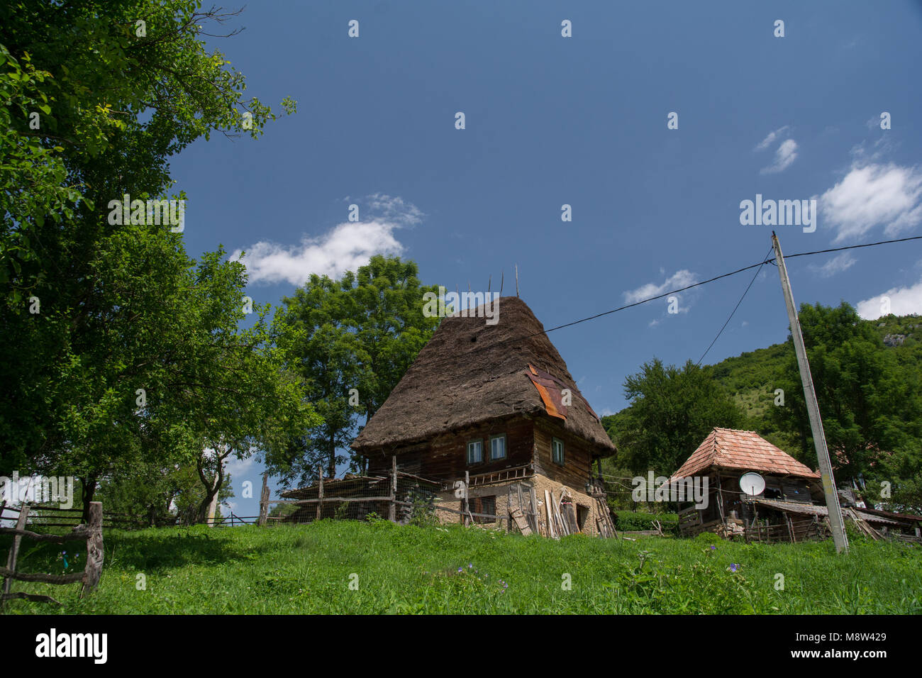 Traditional Wood House Covered With Straw In Apuseni Mountains,  Transylvania, Romania. Vernacular Architecture.