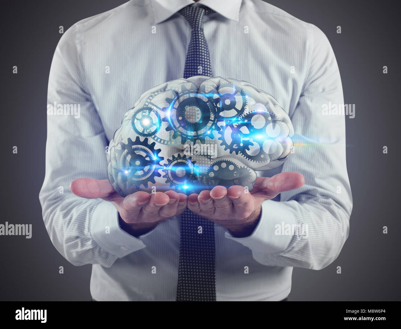 Man holds a brain with gears inside on his hands. 3D Rendering - Stock Image