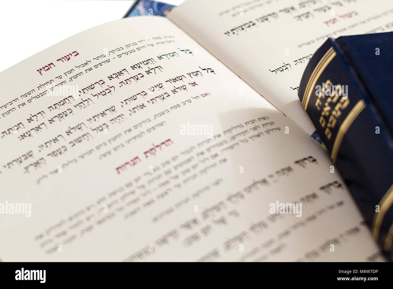Closeup of Hebrew text  in traditional Passover Haggadah 'Eliminating the Leaven'- Judaica Related Isolated - Stock Image