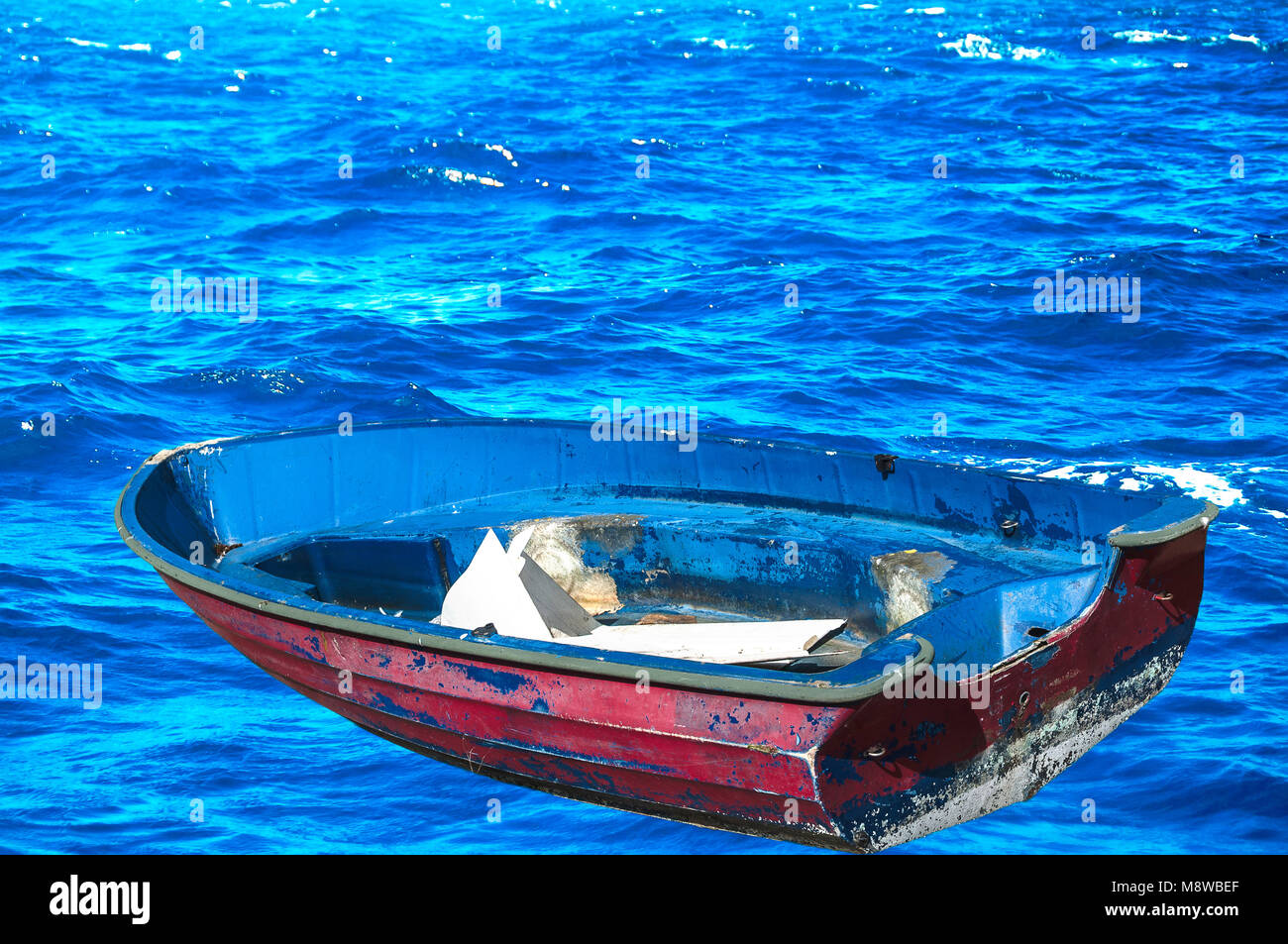 empty boat on the ocean - Stock Image