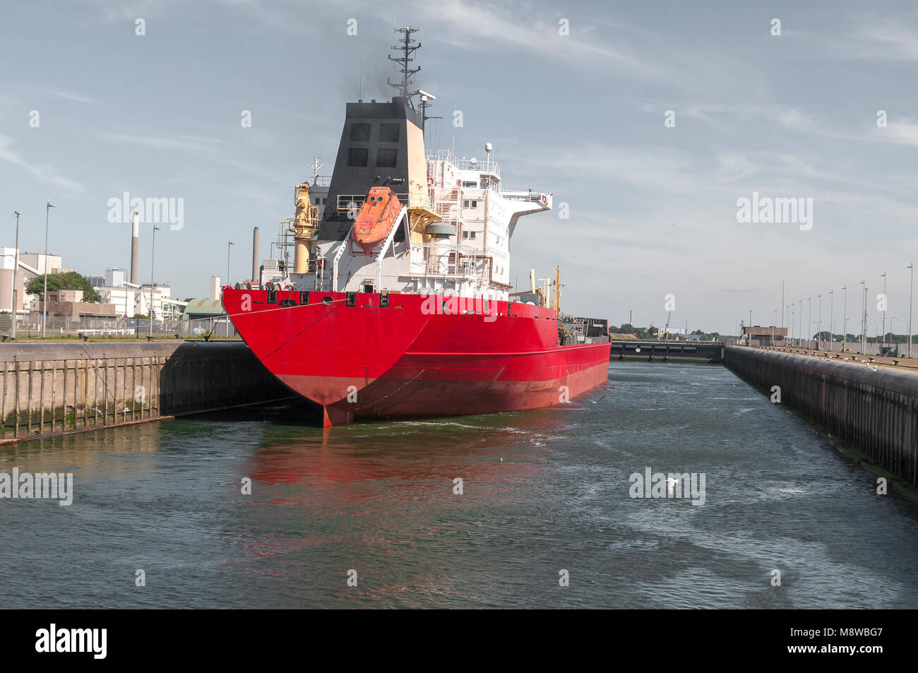 Oil Chemical Tanker Vessel is moored in a large lock - Stock Image