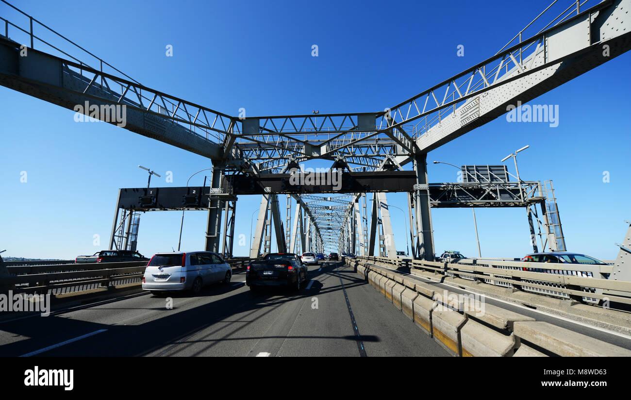 Crossing the Auckland Harbour Bridge. - Stock Image