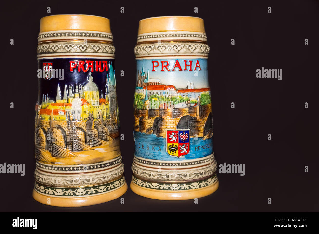 Prague, Czech Republic - February 25, 2018: Closeup of traditional Czech beer mugs on a colored background - Stock Image