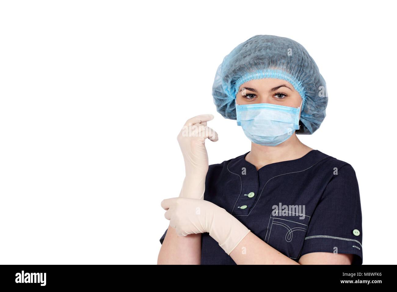 nurse puts on sterile gloves - Stock Image