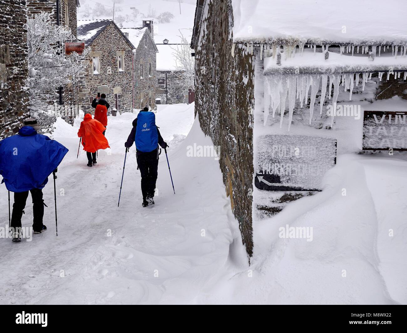 Pilgrims walks no a path covered by snow in O Cebreiro, Lugo, Spain, 20 March 2018. A cold front has arrived to Stock Photo