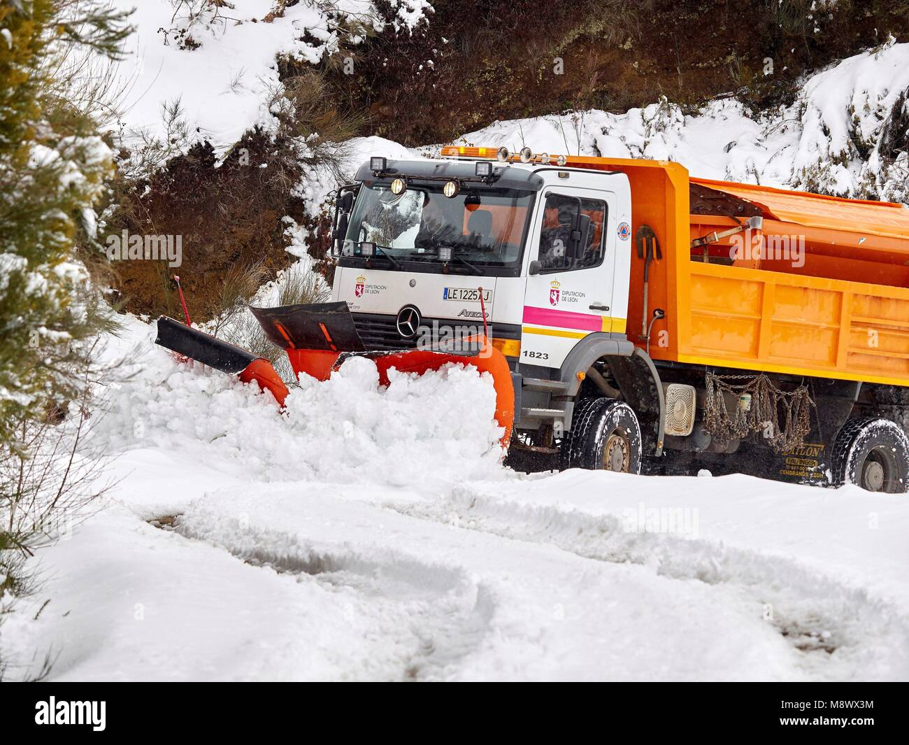 A snowplough clears the snow from the road in O Cebreiro, Lugo, Spain, 20 March 2018. A cold front has arrived to Stock Photo