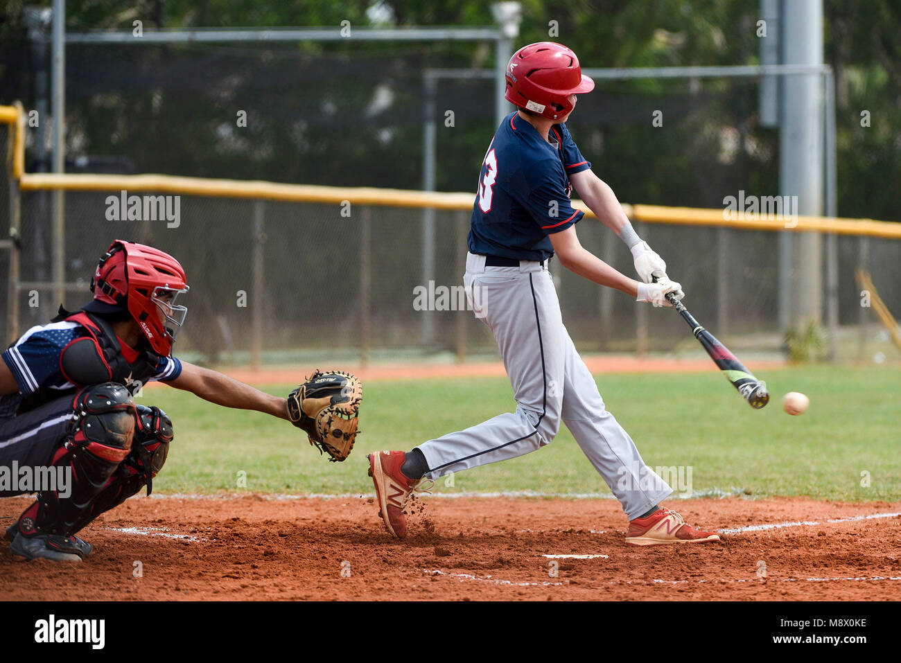 Boca Raton, Florida, USA. 20th Mar, 2018. Oxbridge Academy second baseman Shawn Steurer (33) hits a grounder in Stock Photo
