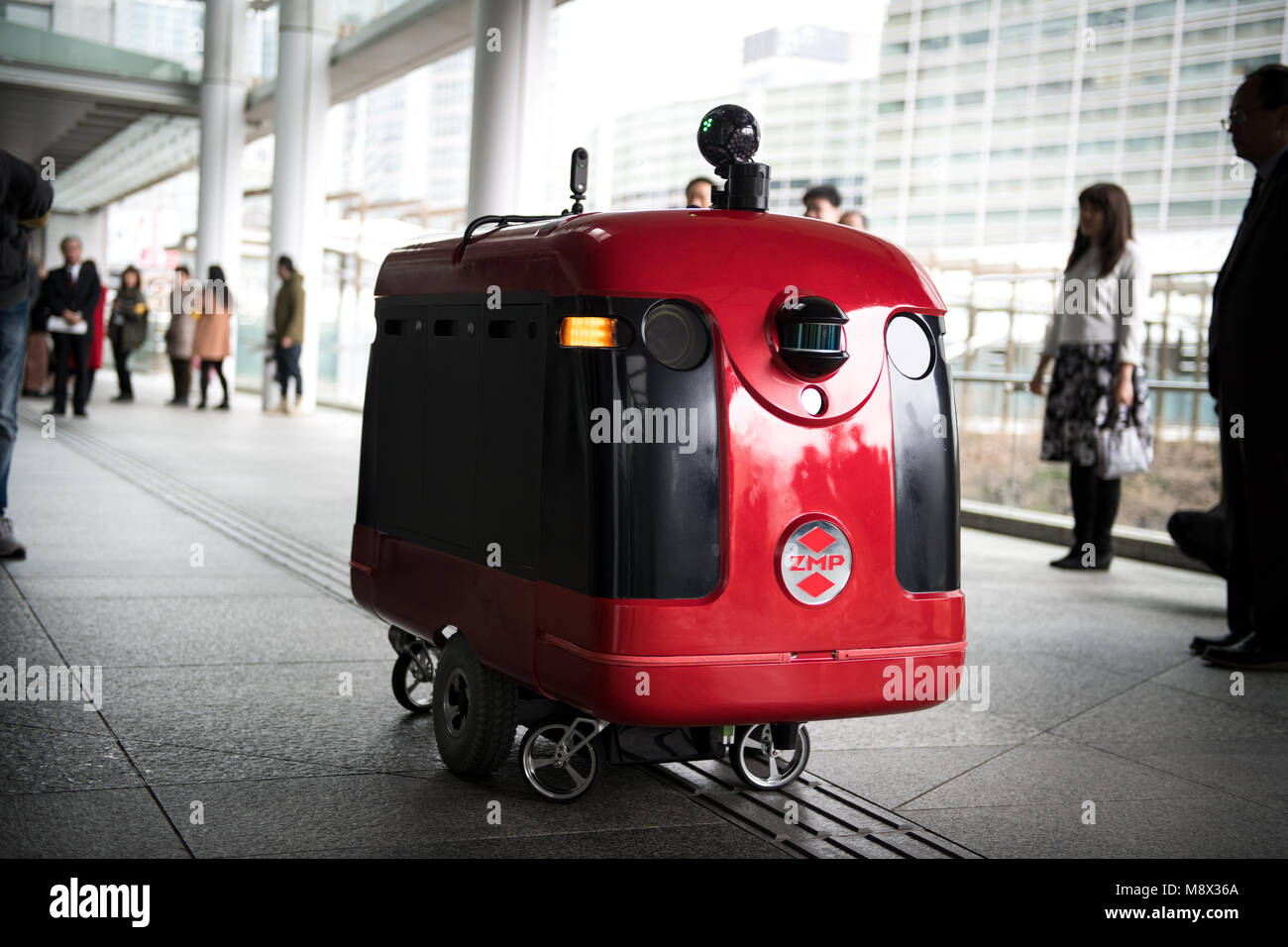 tokyo, japan - march 20: a prototype of a food delivery robot named