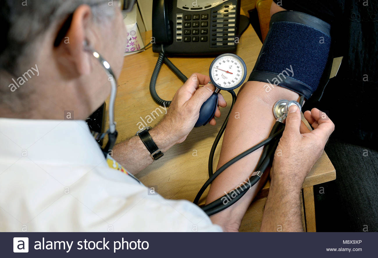 File photo dated 10/09/14 of GP at work. All patients in England will soon be able to be referred to hospitals with - Stock Image