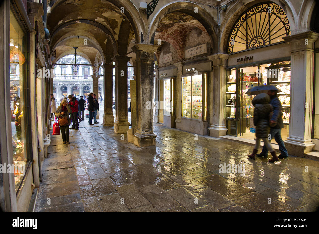 Venetian arcade on a wet day,Venice, Italy. - Stock Image