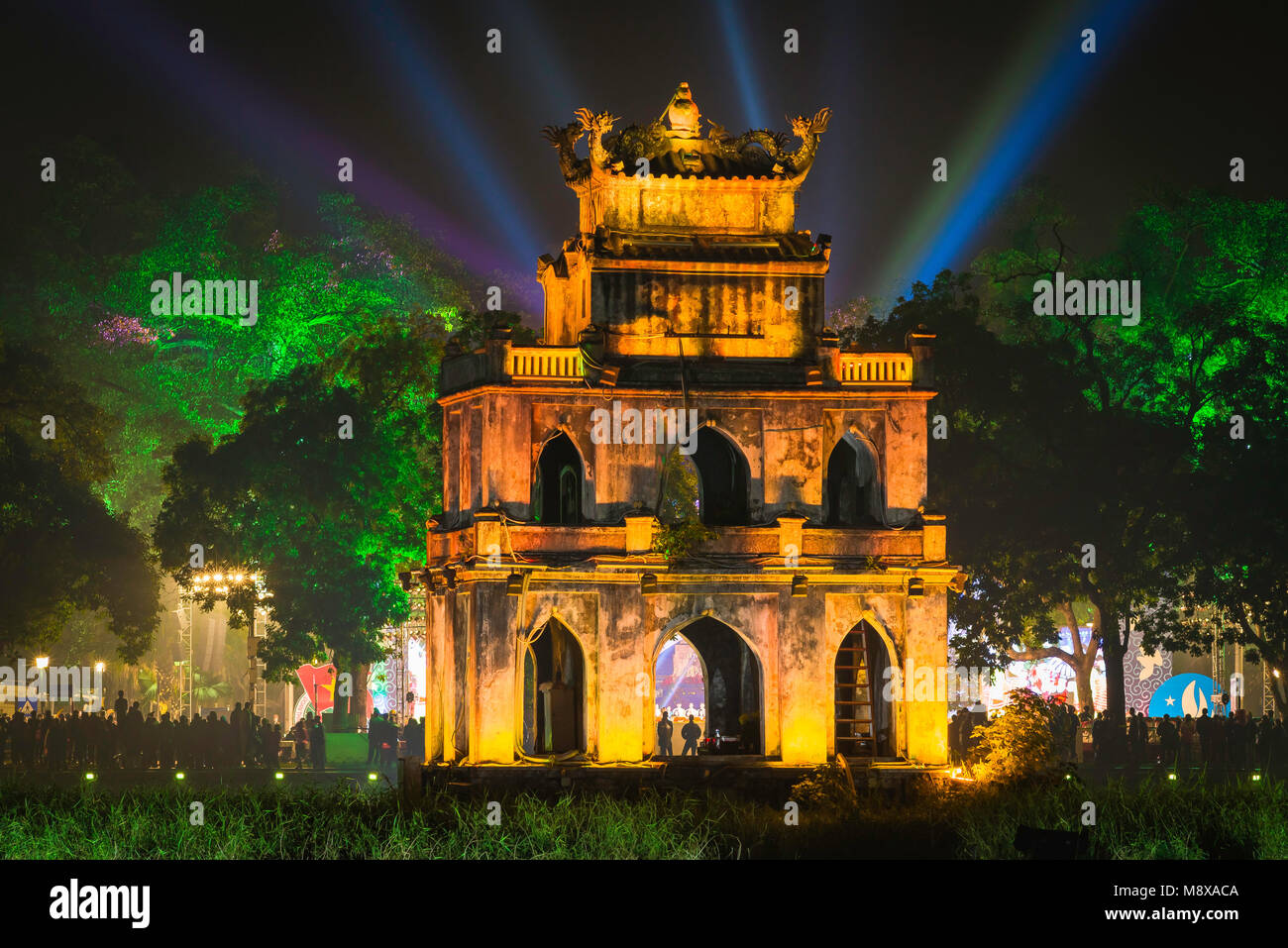 Hanoi Turtle Tower, the old pavilion known as Turtle - or Tortoise - Tower on Hoan Kiem Lake lit by floodlights - Stock Image