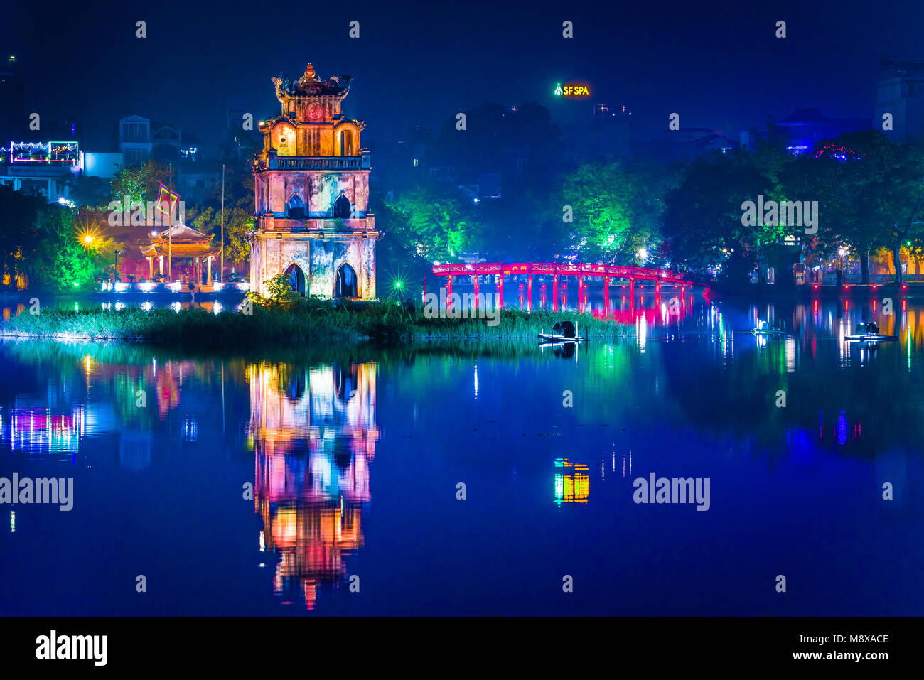 Hanoi Vietnam city, view at night of the old pavilion known as the Turtle (Tortoise) Tower sited in Hoan Kiem Lake - Stock Image