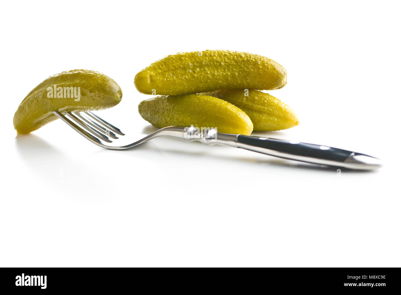 Preserved cucumbers isolated on white background. Tasty pickles. - Stock Image