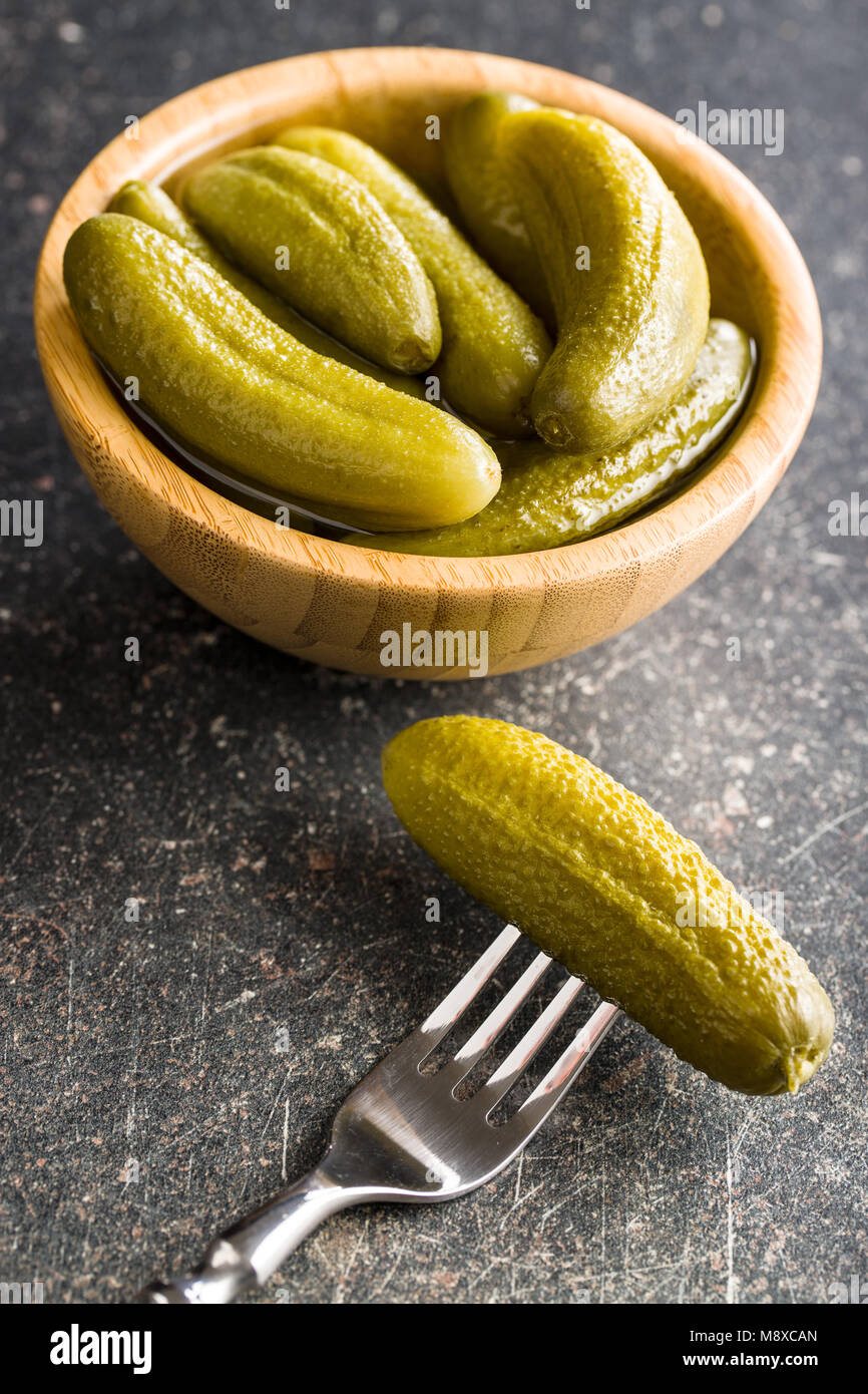 Pickles in bowl. Tasty preserved cucumbers. - Stock Image