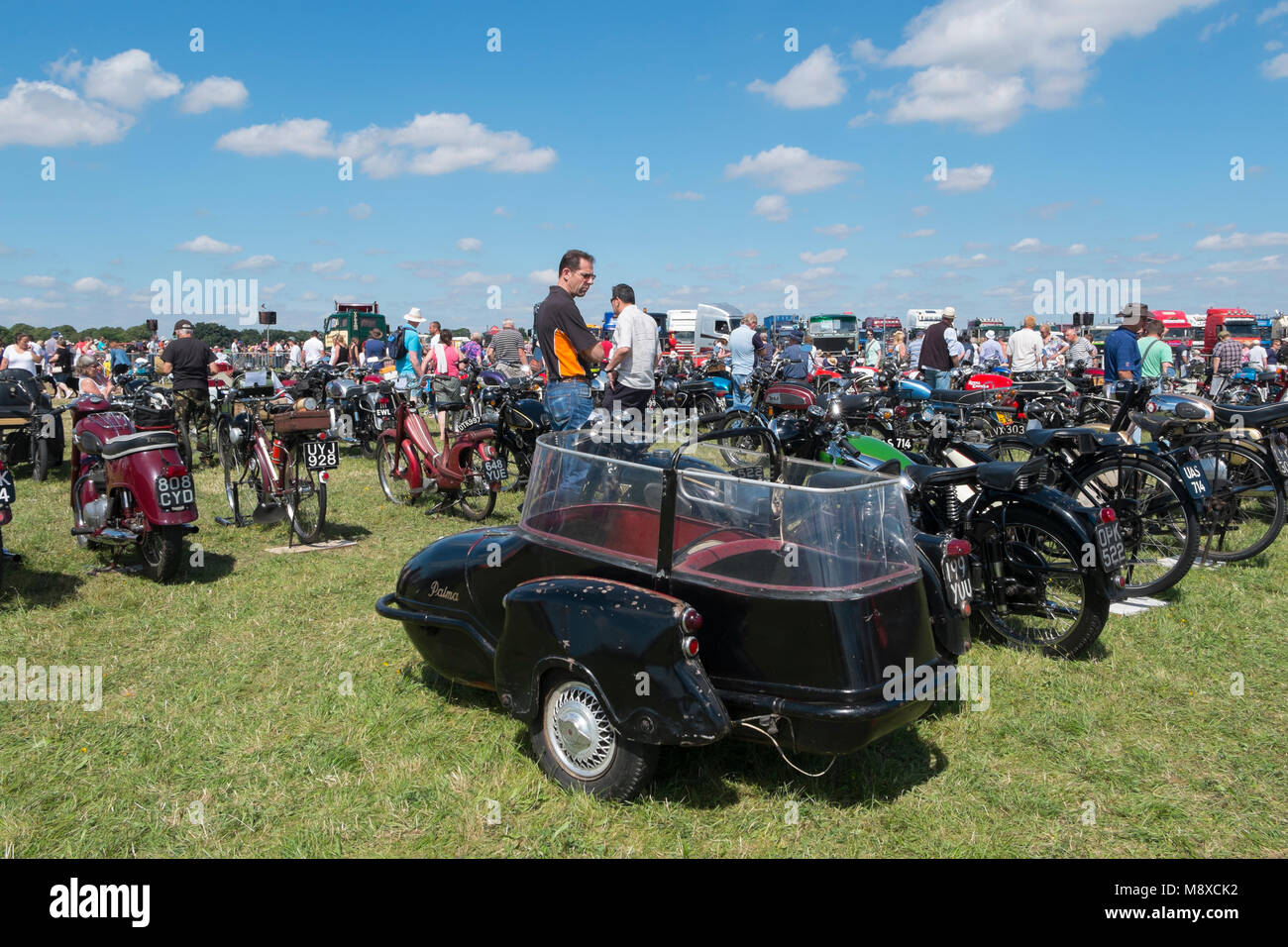 People looking at the old, vintage motorbikes with sidecars at the Gloucestershire Vintage Country Show in Cirencester Stock Photo