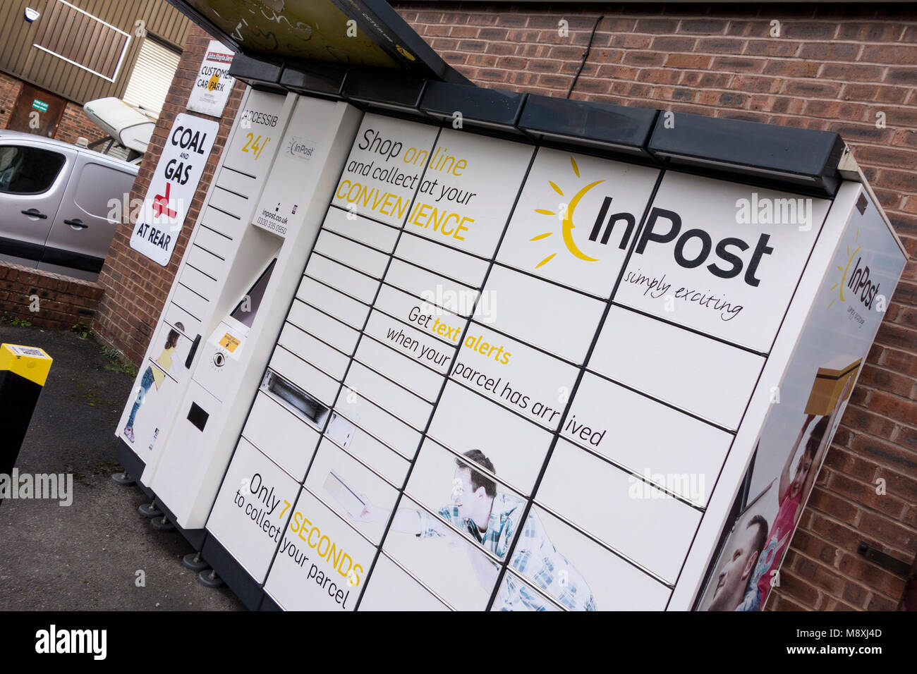 InPost is an alternative click and collect service which lets you pick up your parcel from a secure locker at a - Stock Image