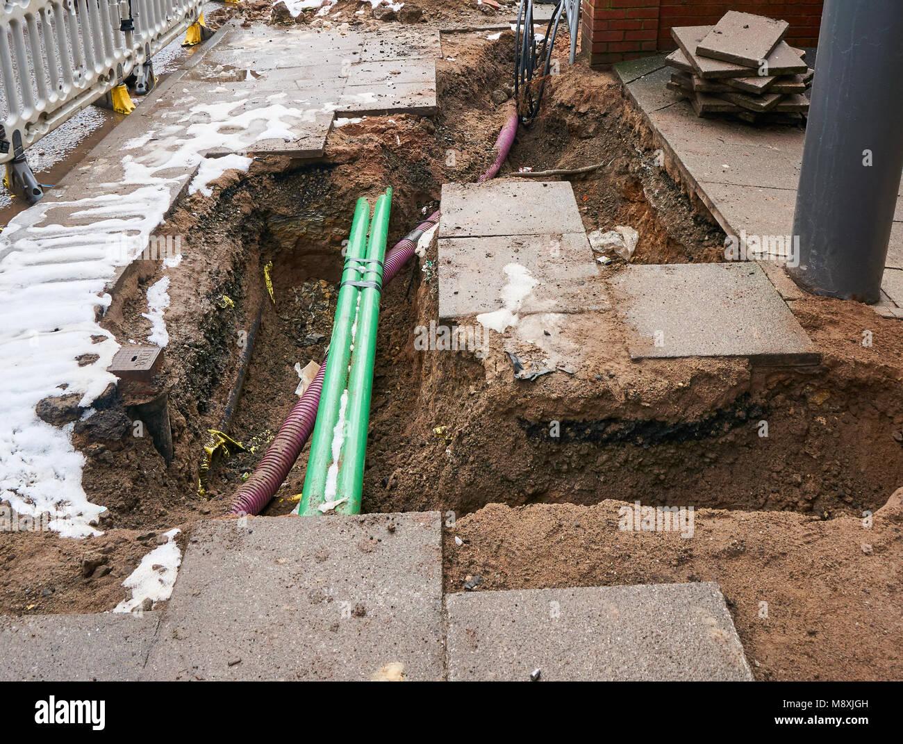 Repair works on underground utilities in Gorbals, Glasgow. - Stock Image