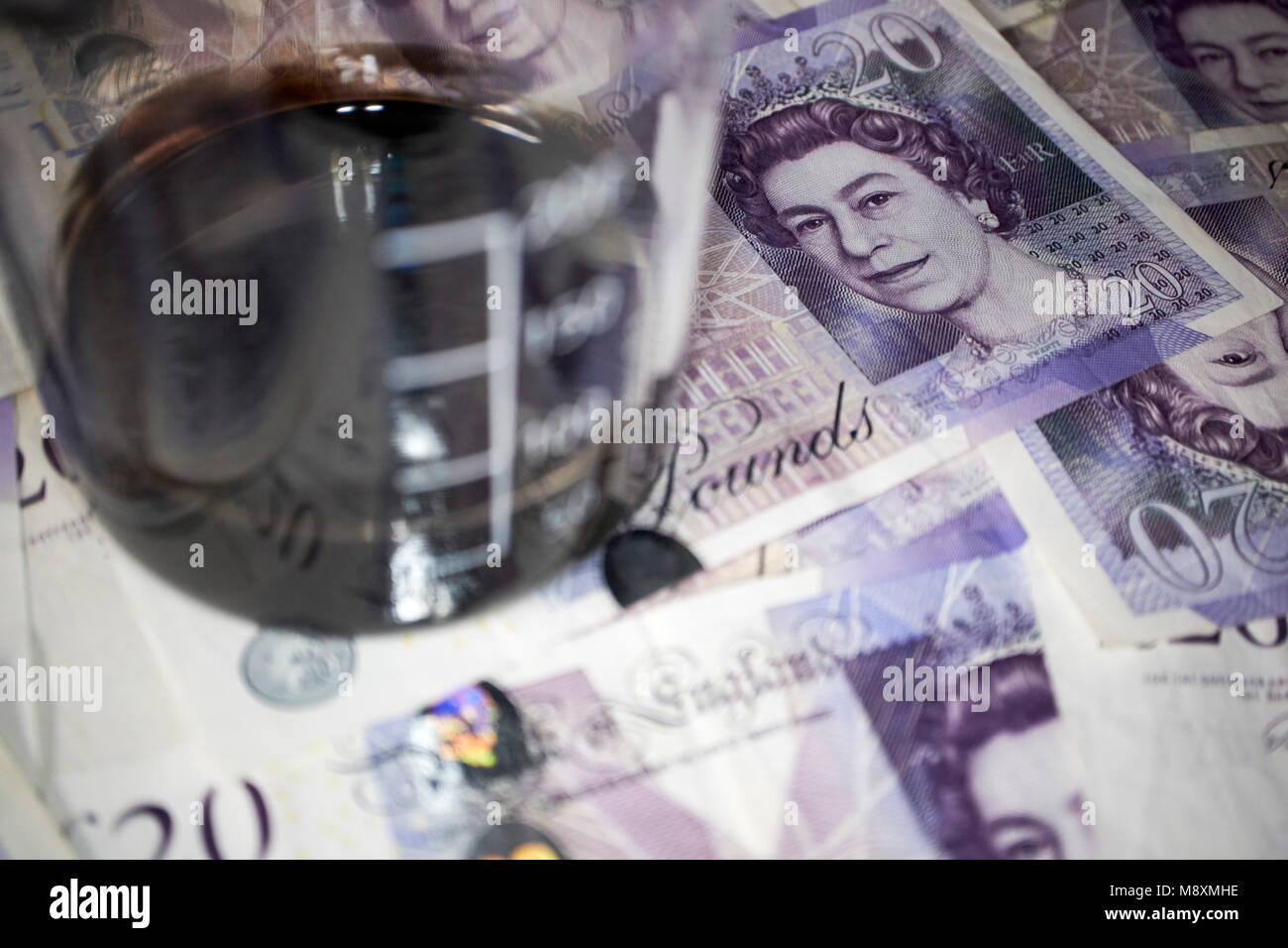 jar of crude oil with british pounds currency trading concept - Stock Image
