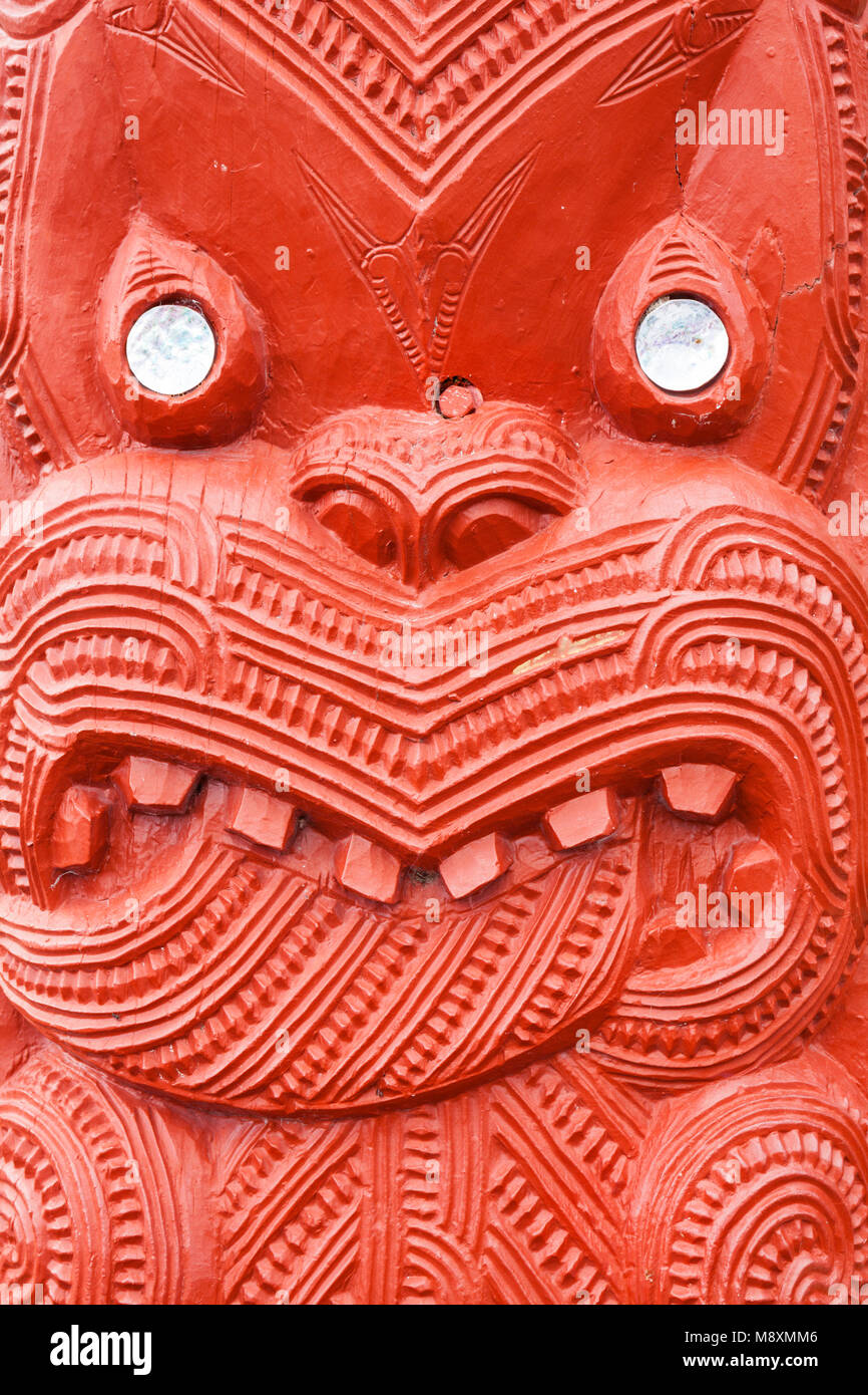 new zealand rotorua new zealand whakarewarewa red maori carving  mother of pearl decoration the meeting house wahiao - Stock Image