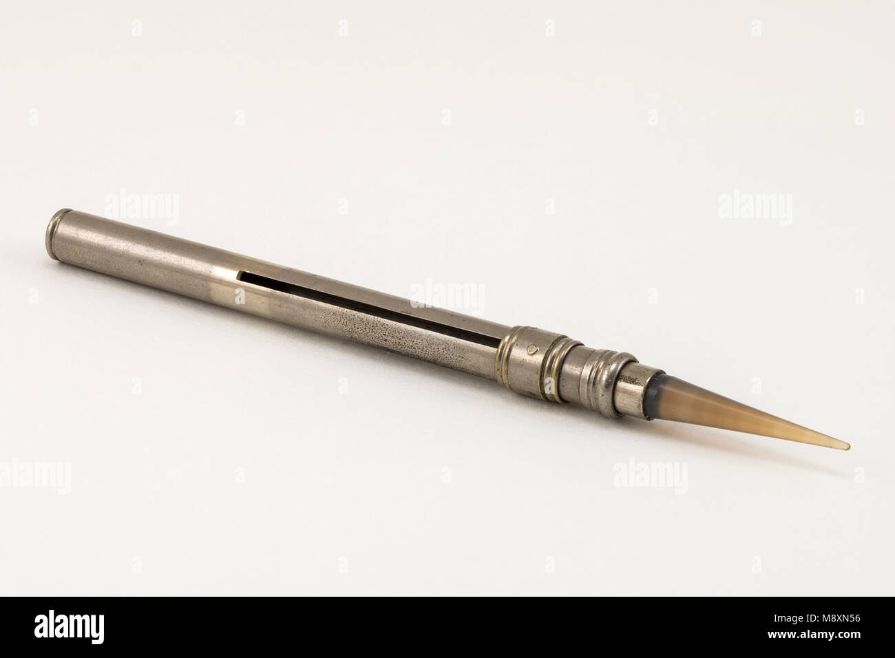 An antique gold leaf burnishing tool with a retractable agate tip. - Stock Image