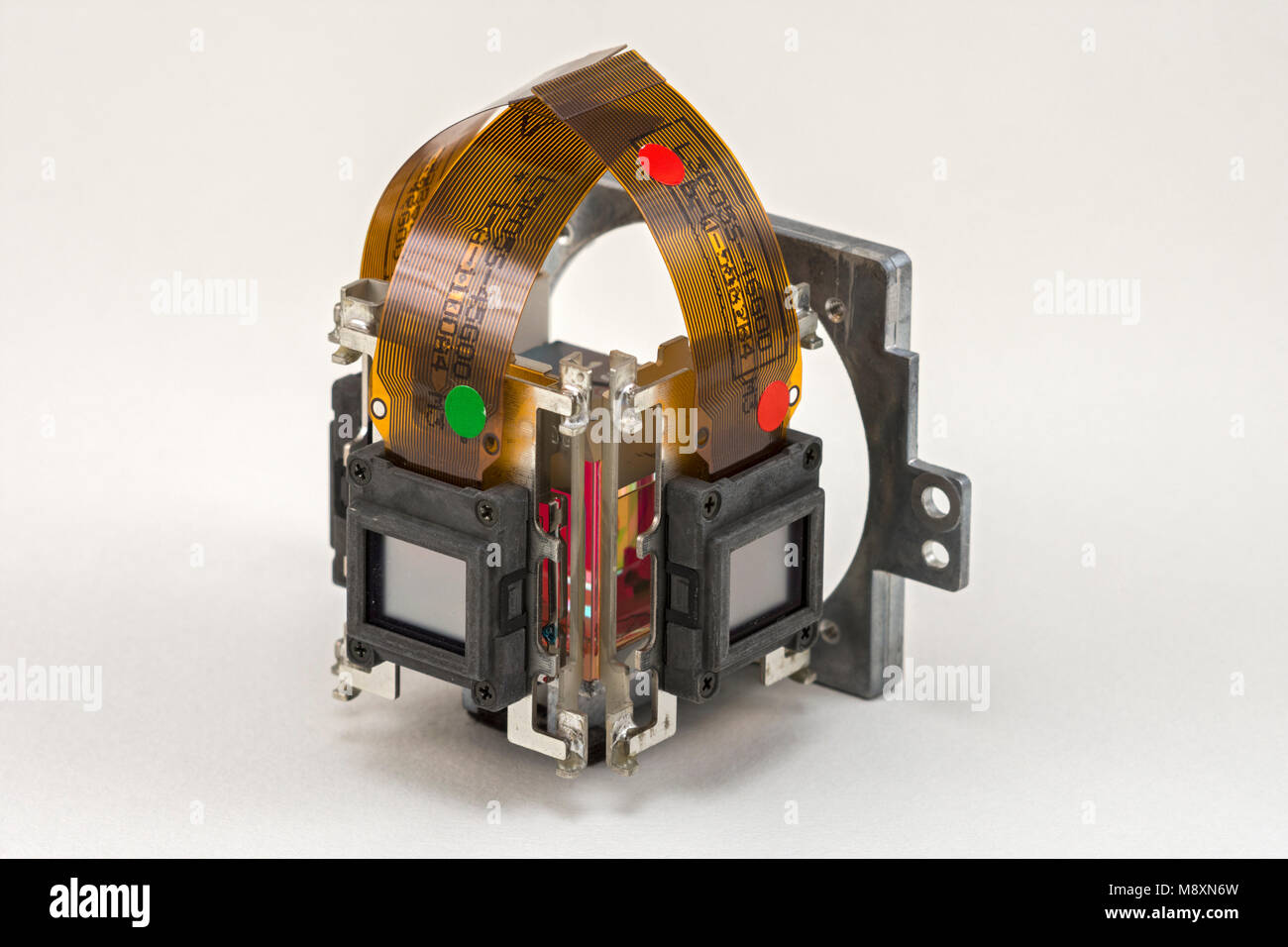 The LCD panels on the dichroic prism assembly of a digital projector.  Showing the green and red channels. - Stock Image
