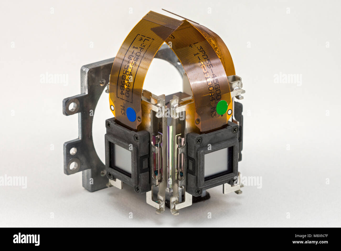 The LCD panels on the dichroic prism assembly of a digital projector.  Showing the blue and green channels. - Stock Image