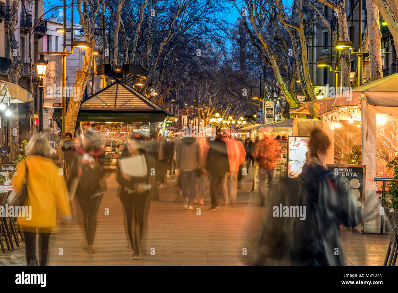 Tourists strolling along the worldwide famous Rambla pedestrian mall, Barcelona, Catalonia, Spain - Stock Image