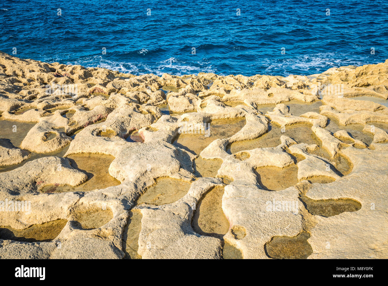 Salt evaporation ponds on Gozo island, Malta - Stock Image