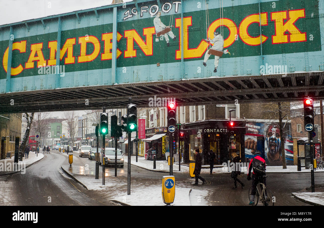 diversion and road ahead closed signs in snow covered street london - Stock Image