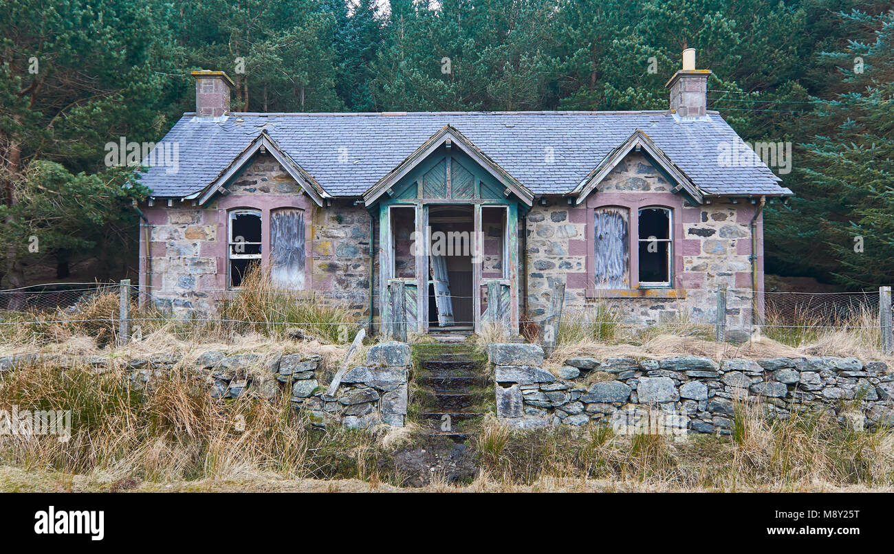 An old derelict stone Victorian Style Cottage beside Loch Lee in the Forests of Glen Esk in the Angus Glens, Scotland. Stock Photo