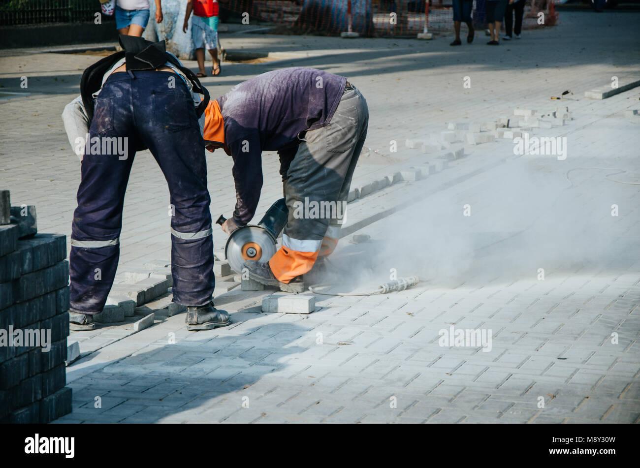 Builder of sidewalks in ravine, Lima - Peru Stock Photo