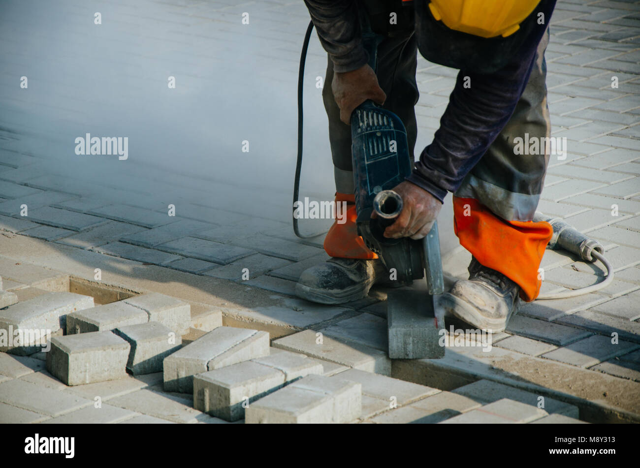 Builder of sidewalks in ravine, Lima - Peru Stock Photo
