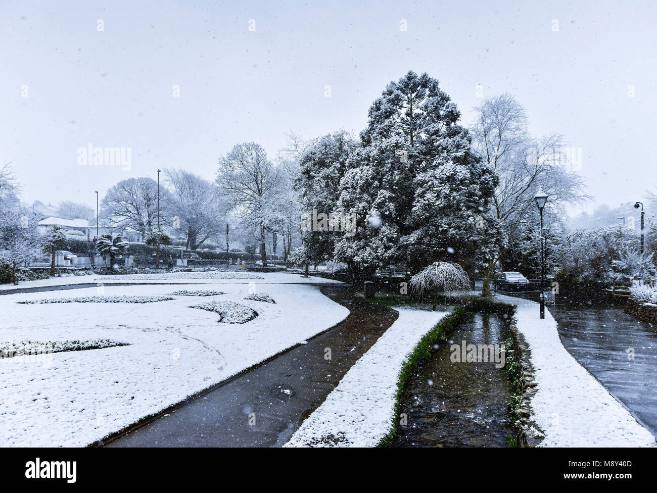 Heavy snow fall on Trenance Gardens in Newquay Cornwall. - Stock Image