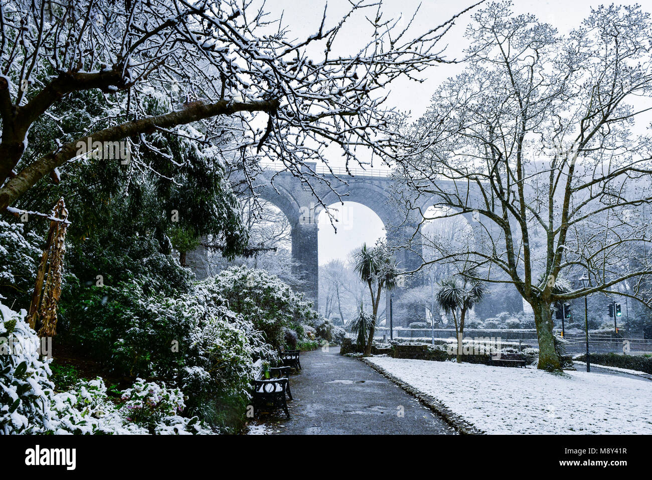Snow falling in Trenance Gardens in Newquay Cornwall. - Stock Image